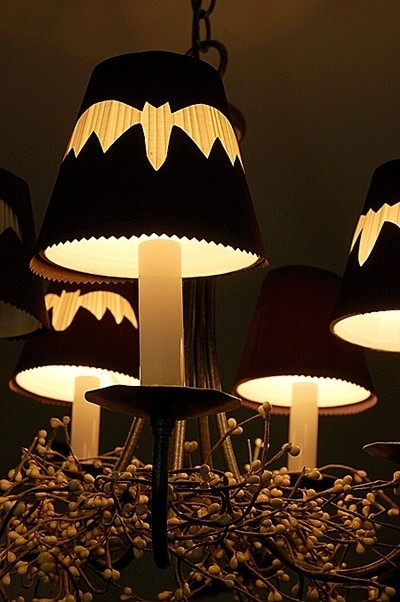 Make little cutouts to fit over the shades on your chandelier! See more on LightsOnline Blog.