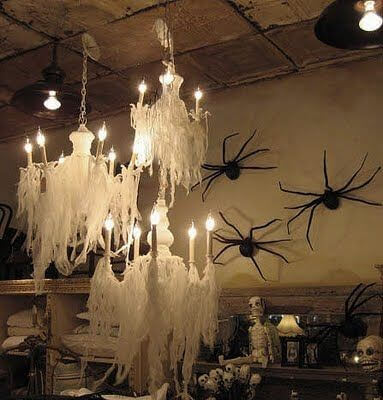 Get this ghostly chandelier look with cheesecloth! Learn more on LightsOnline.com Blog