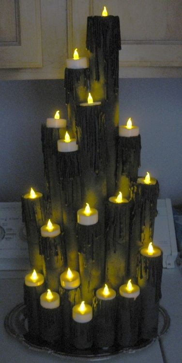 This spooky Halloween candle cluster looks more dangerous than it really is! See more on LightsOnline.com Blog.
