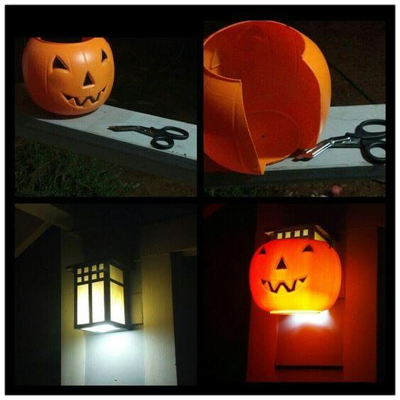 Cut a plastic jack-o-lantern bucket and fit it over your porch light for a bit of Halloween fun. Learn more on LightsOnline.com Blog.