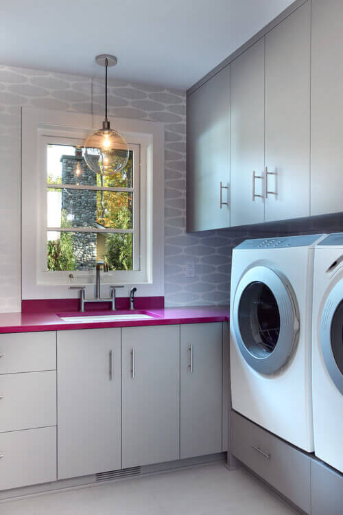 Make your laundry room pop with a peppy pendant light. Photo credit: Contemporary Laundry Room by Grand Rapids Architects & Designers Visbeen Architects