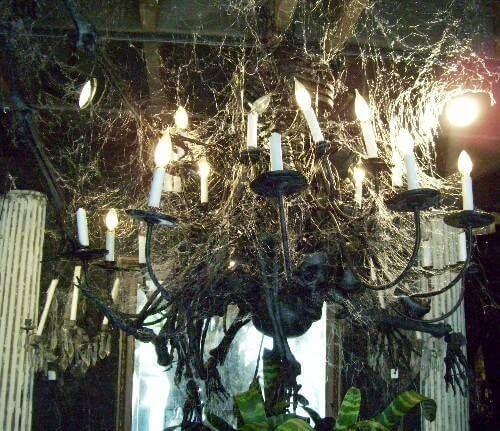 Artfully drape spider webbing on a chandelier for a spooky cool Halloween look. Read more on LightsOnline.com Blog.