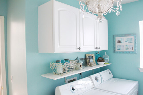 Add a crystal-adorned light to your laundry room! Photo credit: Eclectic Laundry Room