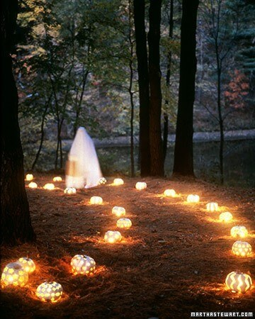 Light the way to your front door with carved pumpkins over light strands! Learn more on LightsOnline.com Blog.