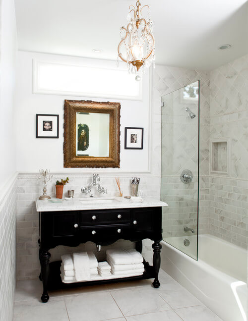 Add a mini chandelier to your bathroom for a glam look! Photo credit: Traditional Bathroom by Thousand Oaks General Contractors JRP Design & Remodel