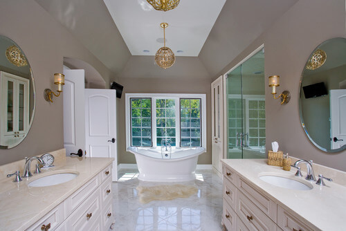 The Feiss Arabesque brightens this beautiful bath. Photo credit: Traditional Bathroom by Chicago Design-Build Firms Orren Pickell Building Group