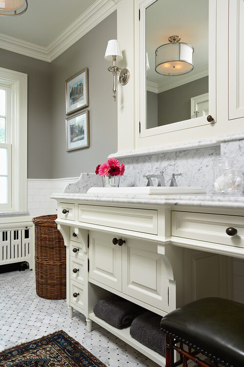 Get this mixed metal look with the Hudson Valley Quincy collection! Photo credit: Traditional Bathroom by Minneapolis Architects & Building Designers Charlie & Co. Design, Ltd