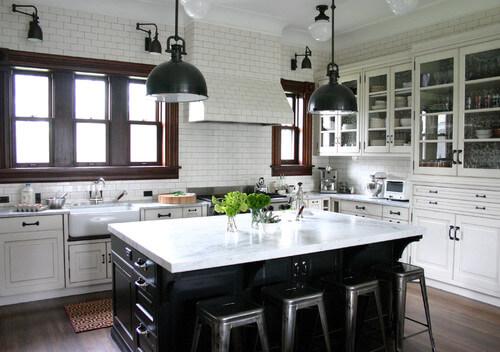 Lighting in dark bronze emboldens this kitchen! Photo credit: Traditional Kitchen by Chicago Kitchen & Bath Designers Rebekah Zaveloff | KitchenLab