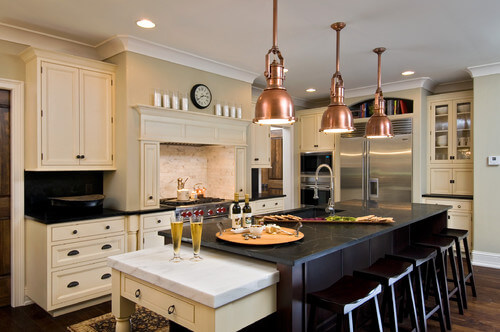 Get this rich copper pendant look with Elk Chadwick! Photo credit: Traditional Kitchen by Saratoga Springs Design-Build Firms Witt Construction