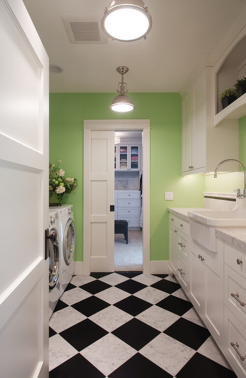 No-nonsense industrial style lights are great for laundry rooms. Photo credit: Traditional Laundry Room by Kirkland Interior Designers & Decorators Kristi Spouse Interiors