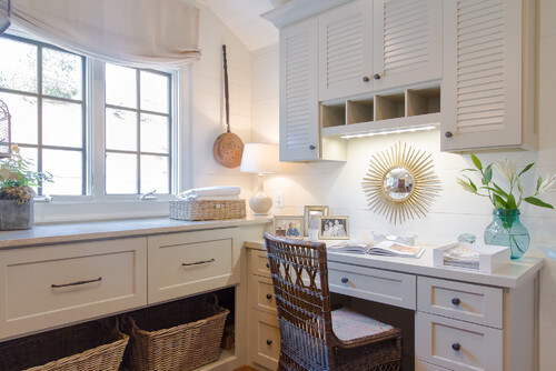 A table lamp is a surprising but smart addition to laundry room lighting. Photo credit: Traditional Laundry Room by Atlanta Interior Designers & Decorators Jessica Bradley Interiors