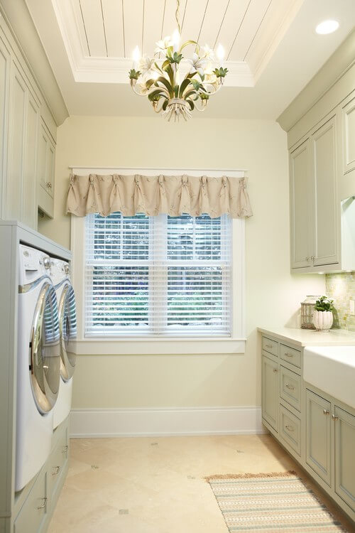 Make your laundry room shine with a pretty chandelier. Photo credit: Traditional Laundry Room by Grand Rapids Architects & Designers Sears Architects